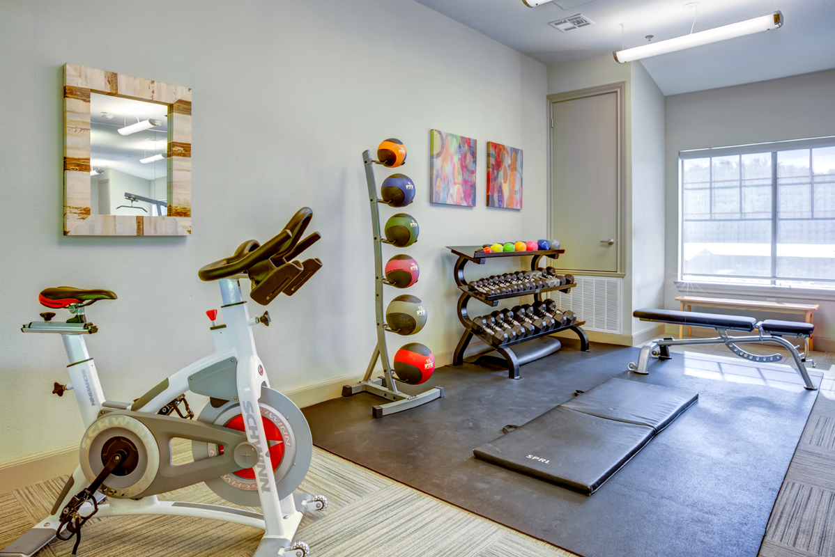 Fitness center with free weights and medicine balls