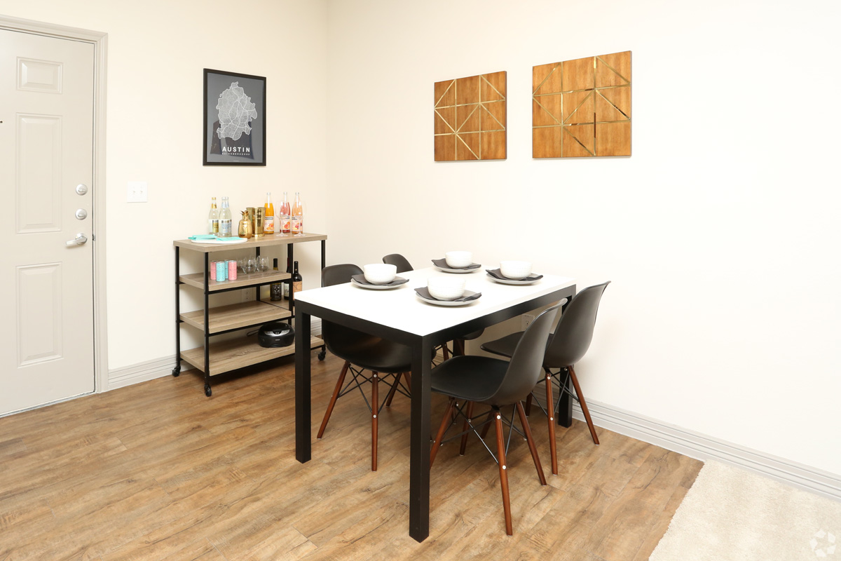 Dining room with wood-style floors, just inside of the apartment front door